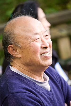 A shot of a happy senior asian couple outdoor photo
