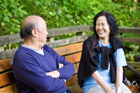 A happy mature asian couple having fun and laughing outdoor Stock Photo