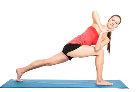A shot of a caucasian woman practicing yoga photo