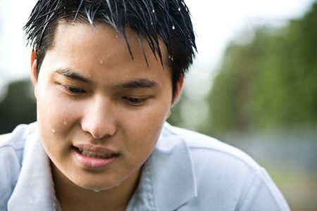 A shot of a sad and depressed asian man Stock Photo