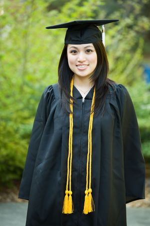cap and gown: A shot of a happy beautiful graduation girl Stock Photo