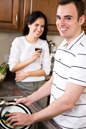 A beautiful interracial couple together in the kitchen photo
