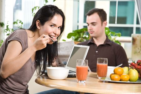 A shot of a couple eating their breakfast at home Stock Photo - 4843706