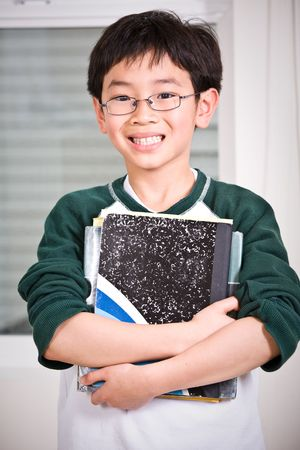 study: A shot of an asian kid carrying books Stock Photo