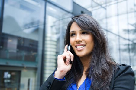 A shot of an indian businesswoman talking on the phone  outdoor Stock Photo - 4913950