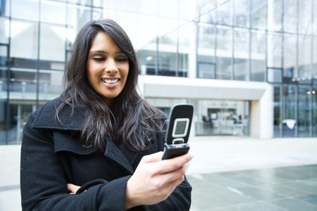 A shot of an indian businesswoman texting on the phone  outdoor Stock Photo - 4913958