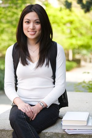 A shot of a beautiful asian college student on campus Stock Photo - 4913951