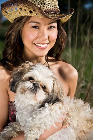 A beautiful girl with her dog outdoor during summer Stock Photo - 4941286