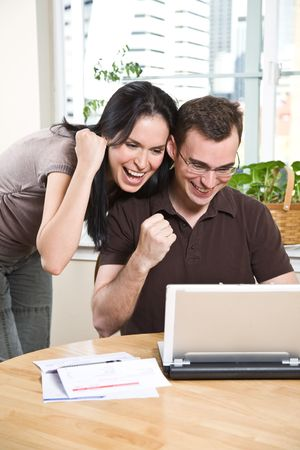 online banking: A happy couple using internet for online banking Stock Photo
