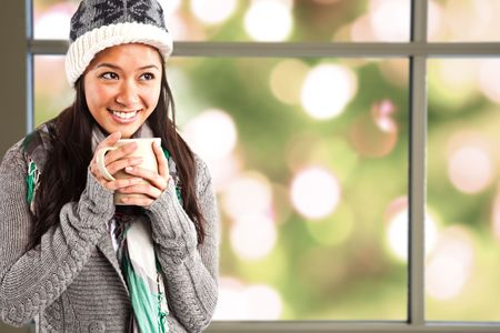 warm drink: A shot of a beautiful asian girl drinking coffee