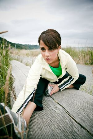 A beautiful asian woman exercises in a park photo
