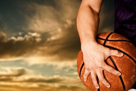 a basketball player: A shot of a basketball player outdoor
