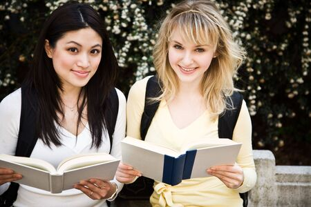 A shot of two college students having a discussion on campus photo