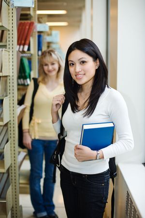 A shot of two college students in a library Stock Photo - 5179471