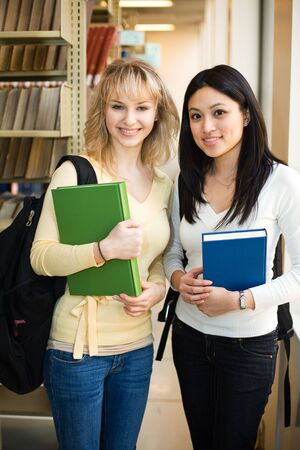 A shot of two college students in a library photo
