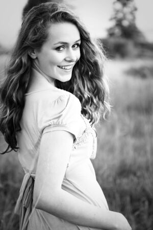 A portrait of a beautiful young caucasian teenage girl in black and white photo