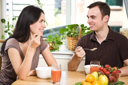 A shot of a couple eating their breakfast at home Stock Photo - 5255636