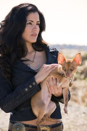 A portrait of a beautiful hispanic woman with her dog photo