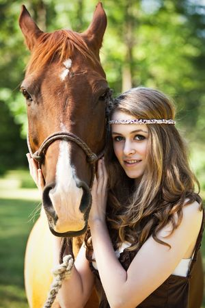 A portrait of a caucasian girl with her horse Stock Photo - 5384403