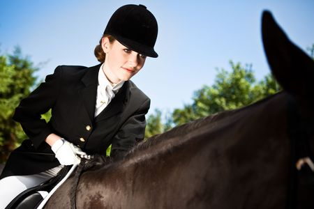 A caucasian teenage girl riding a horse outdoor photo