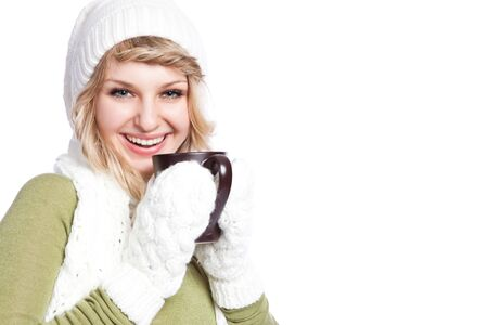 A portrait of a happy beautiful caucasian winter woman holding a coffee cup photo