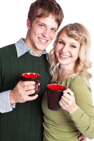 tea hot drink: A portrait of a happy beautiful caucasian couple holding coffee cups
