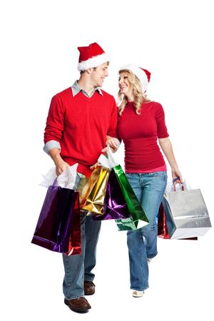 happy shopper: Caucasian couple doing christmas shopping and carrying shopping bags