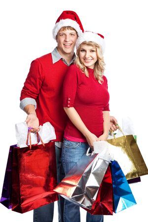 Caucasian couple doing christmas shopping and carrying shopping bags
