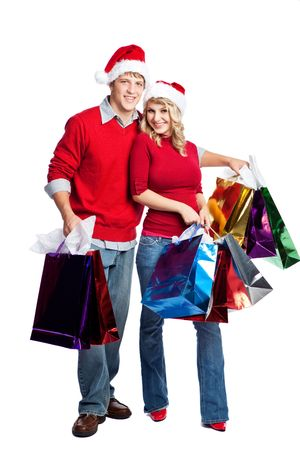 Caucasian couple doing christmas shopping and carrying shopping bags photo