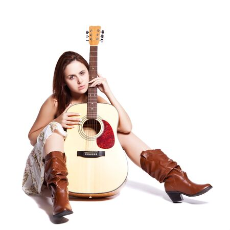 An isolated shot of a beautiful caucasian woman with a guitar