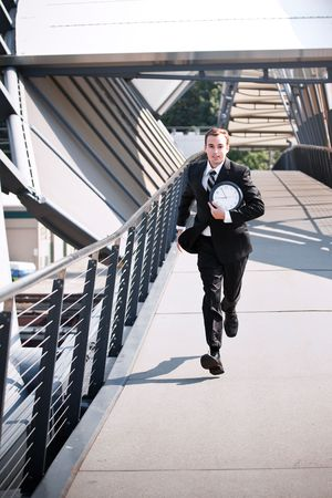 A late caucasian businessman running in a rush photo
