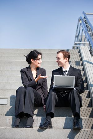 A shot of two business people having a discussion outdoor photo