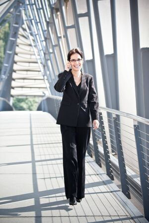 A portrait of a hispanic businesswoman talking on the phone Stock Photo