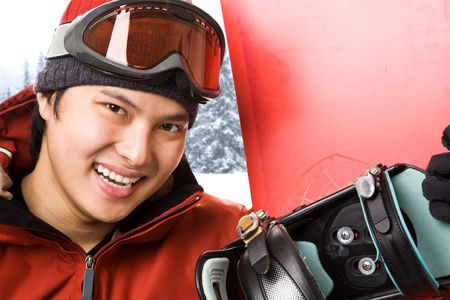 A shot of an asian snowboarder at the ski winter resort photo