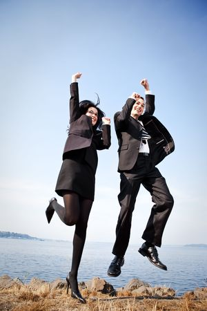 A shot of two happy business colleagues celebrating outdoor photo