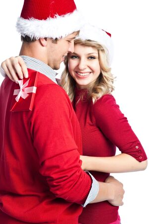 female christmas: A portrait of a happy cute caucasian girl receiving a surprise christmas gift from his boyfriend