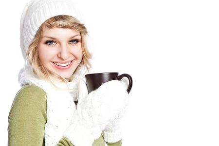 A portrait of a happy beautiful caucasian winter woman holding a coffee cup 写真素材