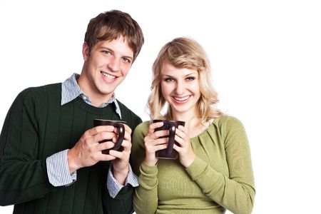 couple winter: A portrait of a happy beautiful caucasian couple holding coffee cups