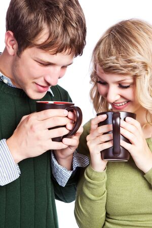 A portrait of a happy beautiful caucasian couple holding coffee cups