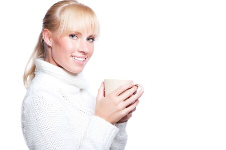 A portrait of a happy beautiful caucasian winter woman holding a coffee cup 스톡 콘텐츠