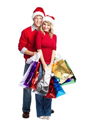 Caucasian couple doing christmas shopping and carrying shopping bags Stock Photo - 5749659