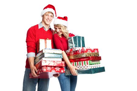 holiday spending: Caucasian couple doing christmas shopping and carrying gifts Stock Photo