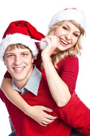 A portrait of a happy  caucasian christmas couple doing a piggback ride photo