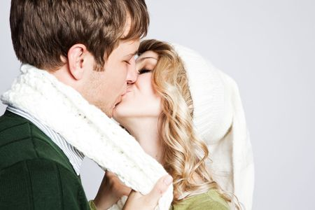 romance: A portrait of a happy  kissing caucasian couple Stock Photo