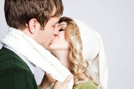 winter woman: A portrait of a happy  kissing caucasian couple Stock Photo