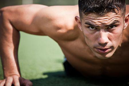 A shot of a hispanic athlete doing a push-up