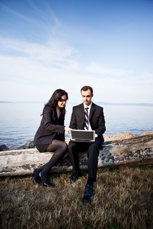 A shot of two business colleagues working together outdoor photo