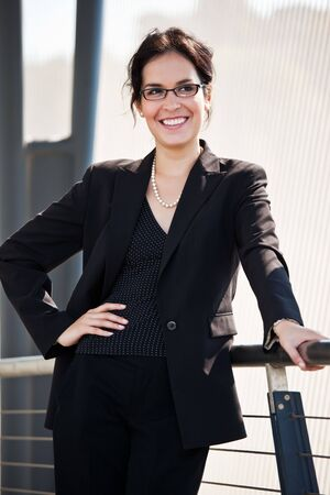 A portrait of a hispanic businesswoman outdoor photo