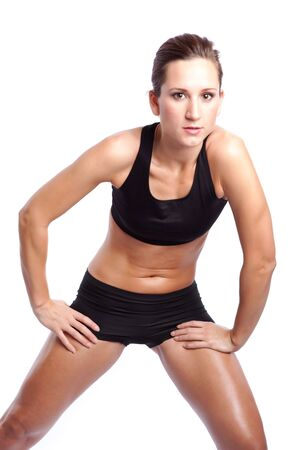 An isolated shot of a beautiful caucasian woman doing exercise Stock Photo - 5848534