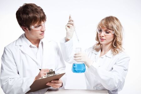 A shot of a male and female caucasian scientists photo